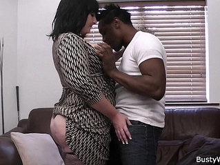 Busty mature lady boss in fishnets loves black meat