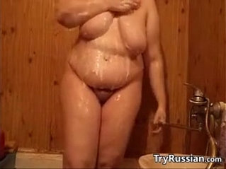 Big russian woman washes her fat body